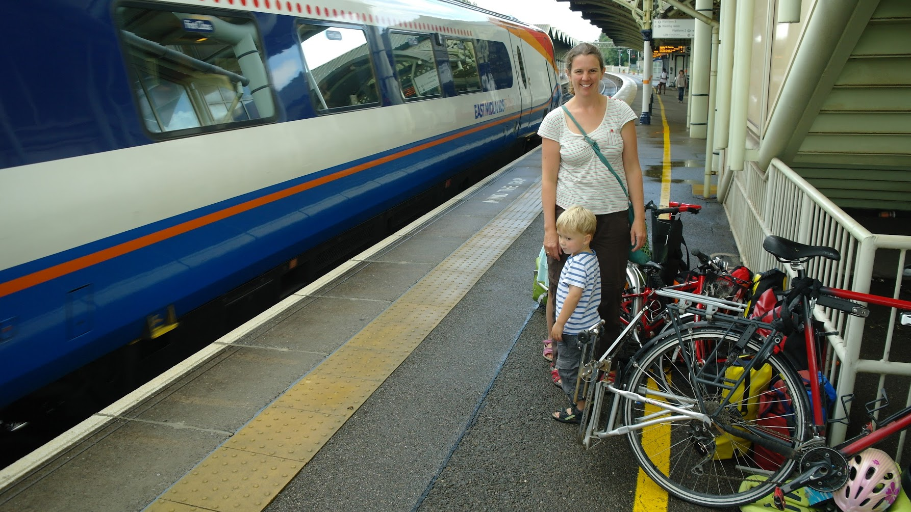 Getting ready at Kettering station for taking bicycles on the train with kids