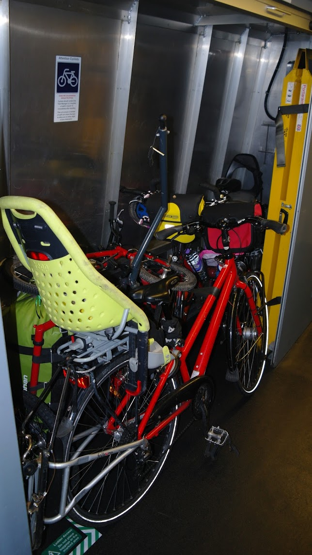 4 bicycles on the train with kid's bike seat, follow-mes and luggage trailer on a Virgin Pendolino