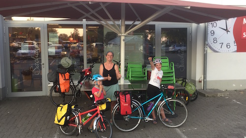 Outside a German supermarket with our bikes, after stocking up for the Finnlines ferry.