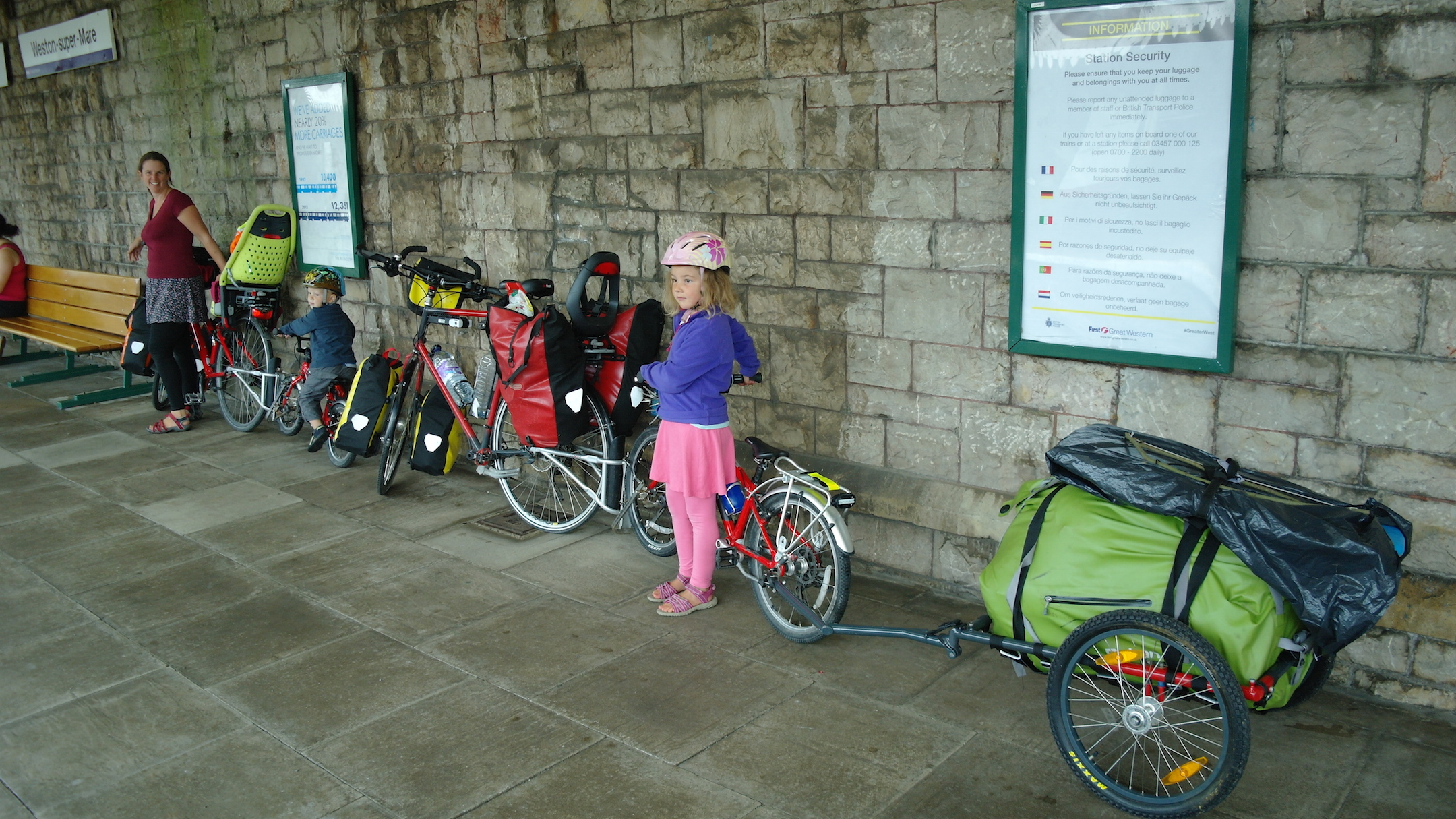 Waiting to put a family of four with bicycles on the train.