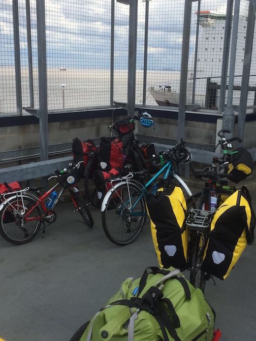 Waiting to board the Hull ferry with children on bicycles.
