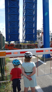 Stopping to watch a swing bridge on our Netherlands family cycling holiday.
