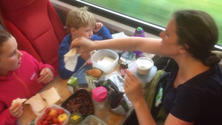 Picnic on the train makes family train travel easier.